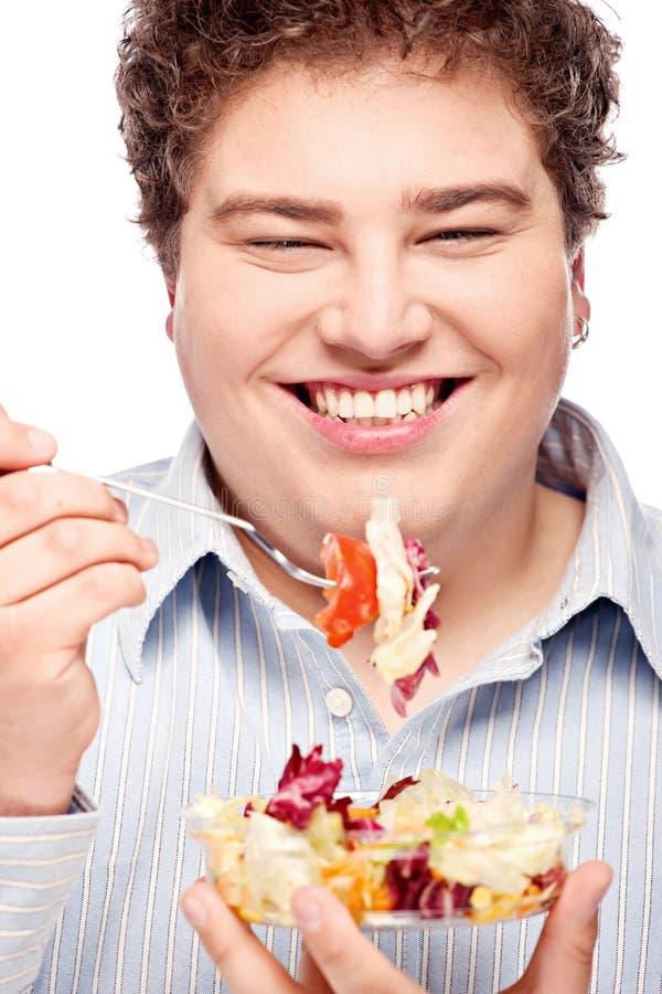 胖的人和沙拉 免版税库存照片