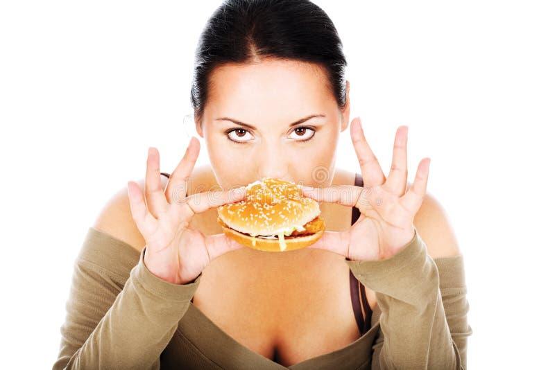 胖的快餐女孩 库存图片