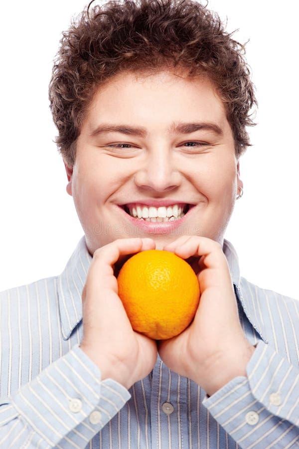 胖的男孩和桔子 库存图片