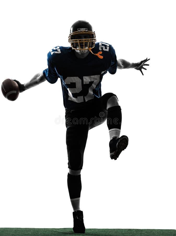 胜利的美国橄榄球运动员人剪影 免版税库存照片