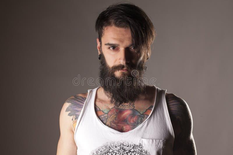 胡子和纹身花刺 免版税库存图片
