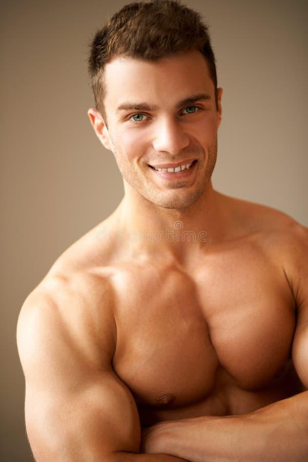 胳膊供以人员肌肉纵向微笑 库存照片