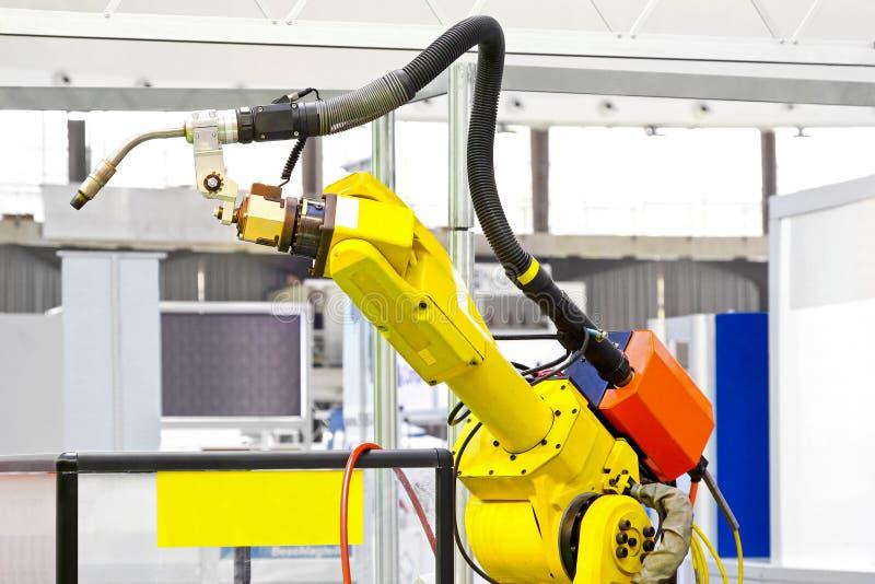 胳膊机器人焊工 库存照片