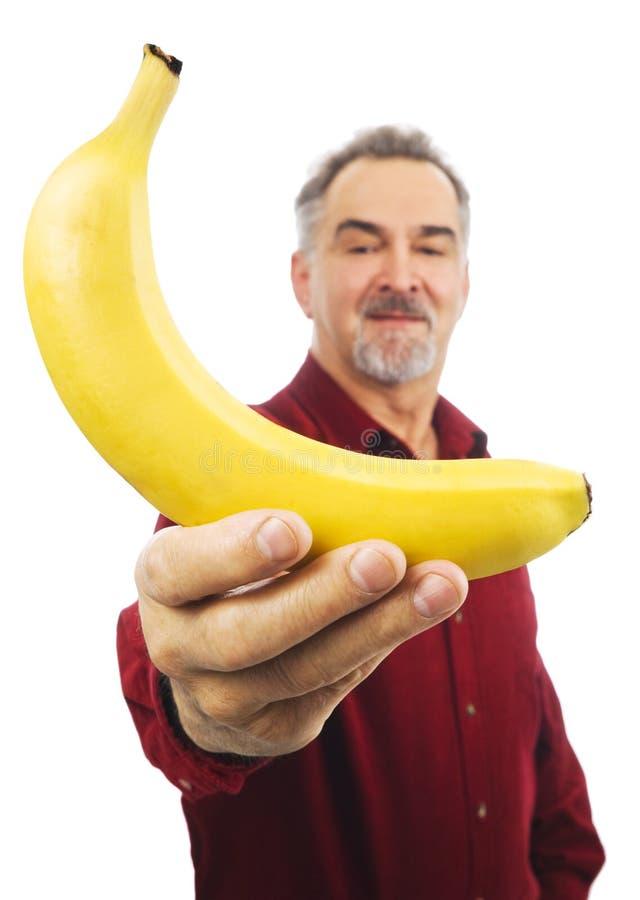 胳膊香蕉人聘用伸出黄色 免版税图库摄影