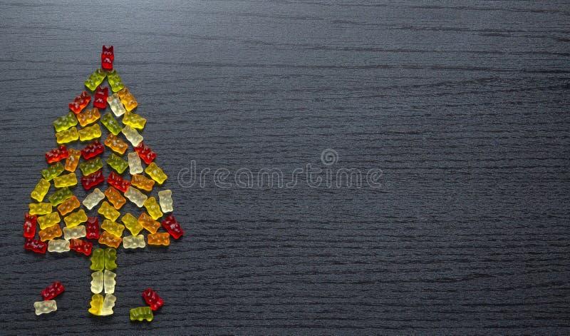 胶粘的小雕象圣诞树卡片 库存图片