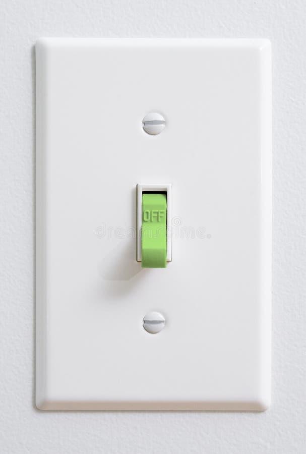能承受的干净,绿色能量灯开关 免版税库存照片