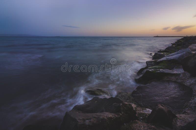 脚趾海滩日落 库存图片