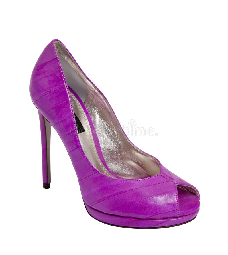 脚跟高紫色鞋子妇女 免版税库存图片