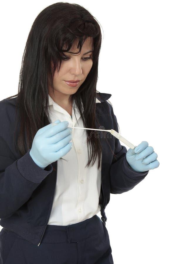 脱氧核糖核酸调查员警察抽样 免版税库存照片