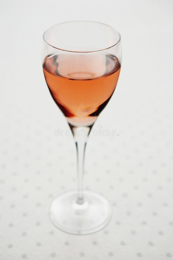 脸红玻璃酒 免版税库存图片
