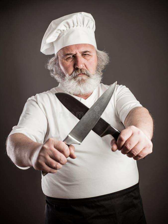 脾气坏的老厨师 库存图片