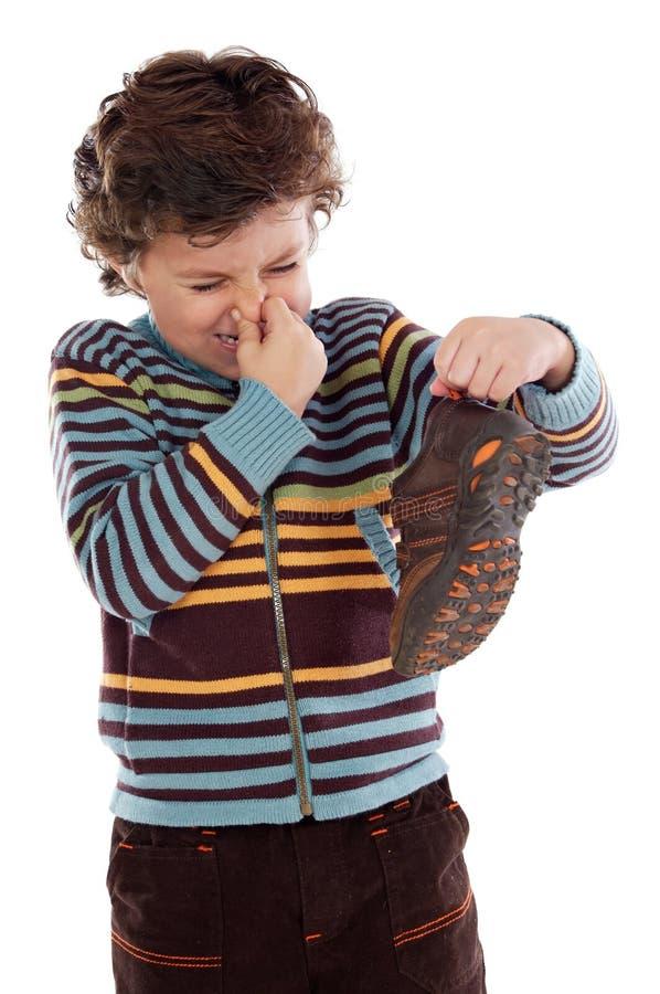 腐败男孩的鞋子 免版税库存照片