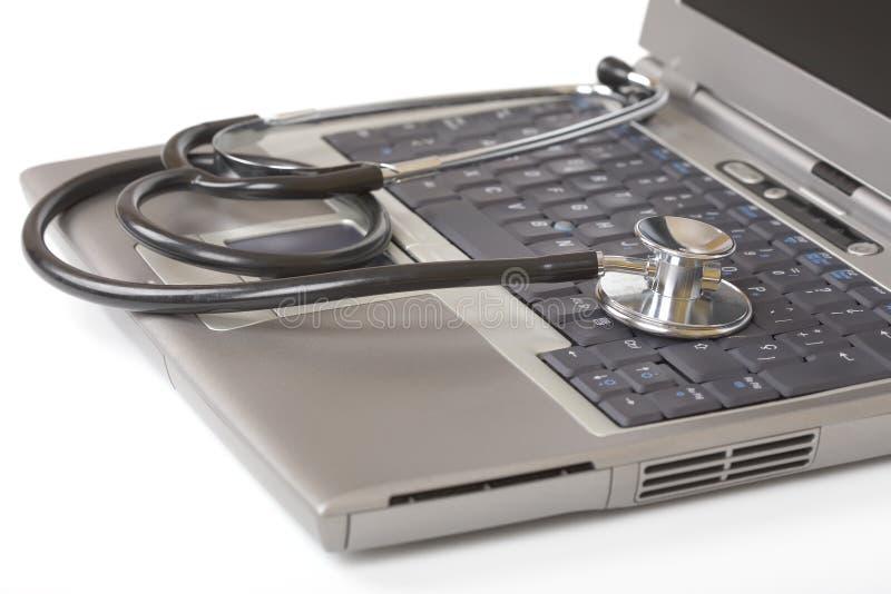 膝上型计算机听诊器 免版税库存图片