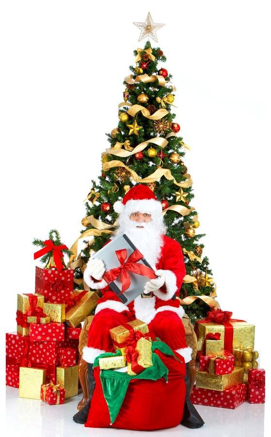 膝上型计算机圣诞老人微笑 免版税库存照片