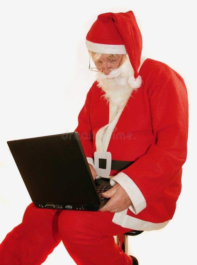 膝上型计算机圣诞老人 免版税库存图片