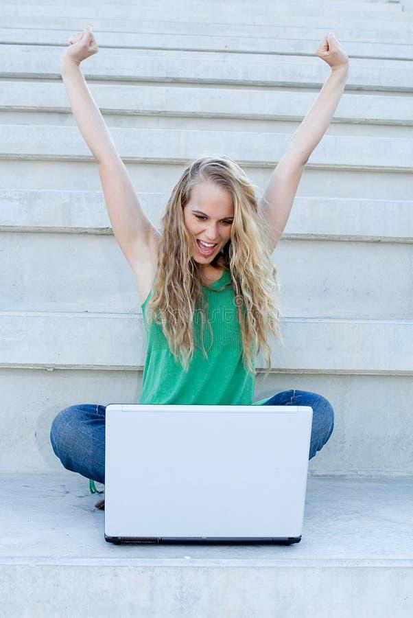 膝上型计算机成功的妇女 图库摄影