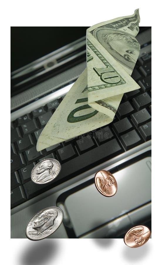 膝上型计算机货币笔记本 库存图片