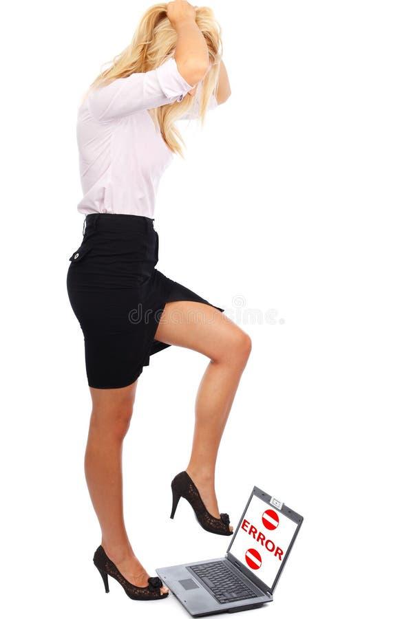 膝上型计算机践踏妇女 图库摄影