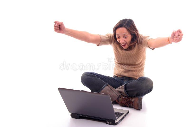 膝上型计算机v妇女 库存图片