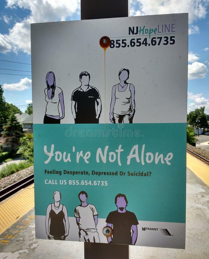 自杀热线服务电话标志,您不是单独的,呼叫请求帮助 库存图片