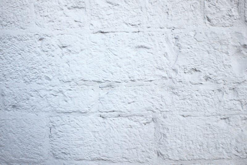 自然不对称的白色石头背景  免版税库存图片