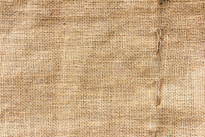 自然大袋纹理褐色帆布织品设计 免版税库存照片