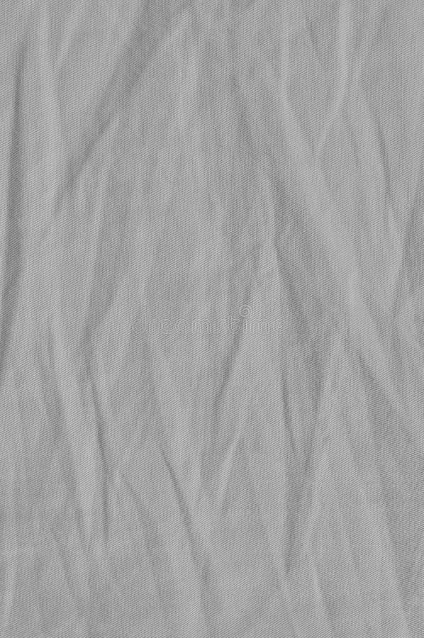 自然明亮的亚麻制棉花丝光斜纹棉布牛仔裤纹理,详细的特写镜头,土气被弄皱的葡萄酒构造了织品粗麻布对角线斜纹布 库存照片