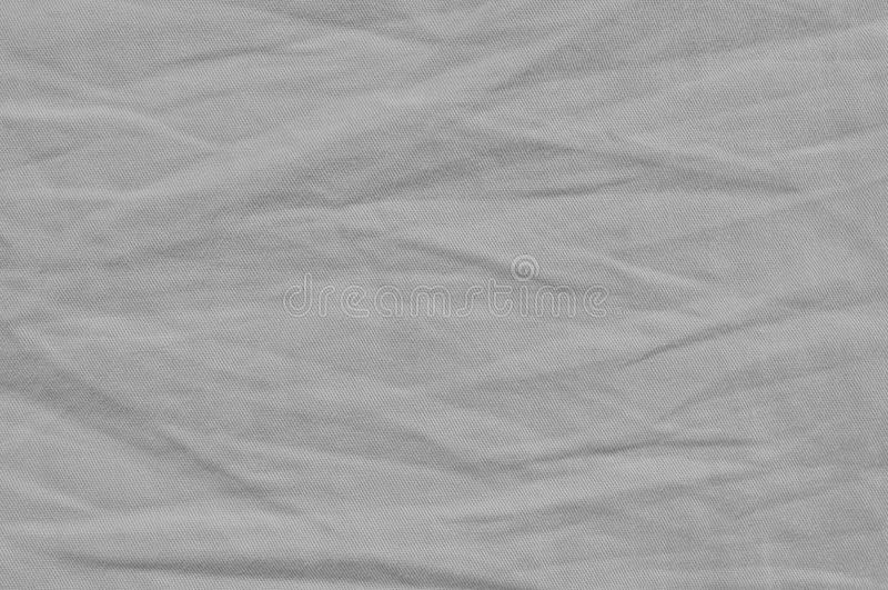 自然明亮的亚麻制棉花丝光斜纹棉布牛仔裤纹理,详细的特写镜头,土气被弄皱的葡萄酒构造了织品粗麻布对角线斜纹布 免版税库存照片