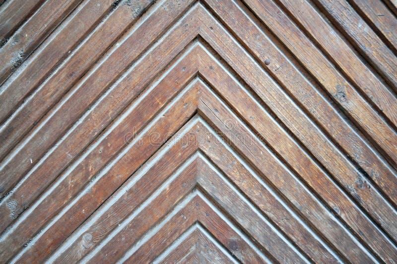 自然木背景人字形,难看的东西木条地板地板设计 库存照片