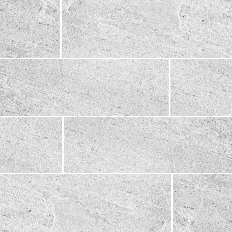 自然沙子石头瓦片墙壁无缝的背景和纹理 库存照片