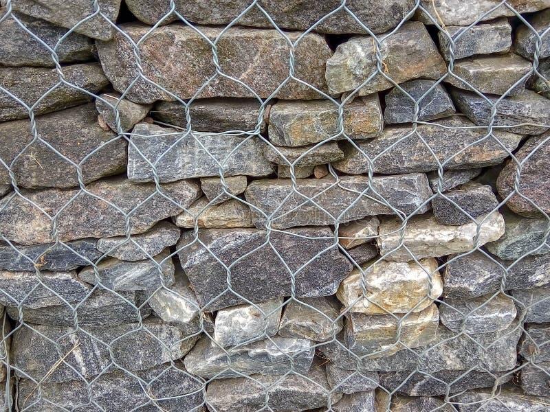 自然灰色石头背景拉紧与滤网 免版税库存照片