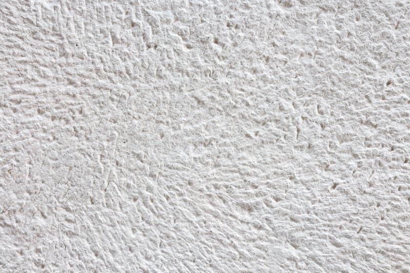自然白色石表面背景纹理的片段 图库摄影