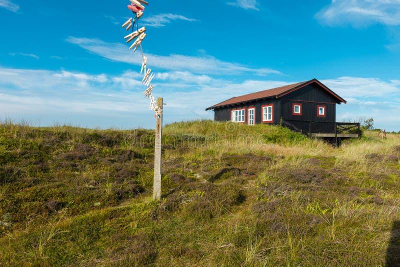 自然的木房子在丹麦 库存照片