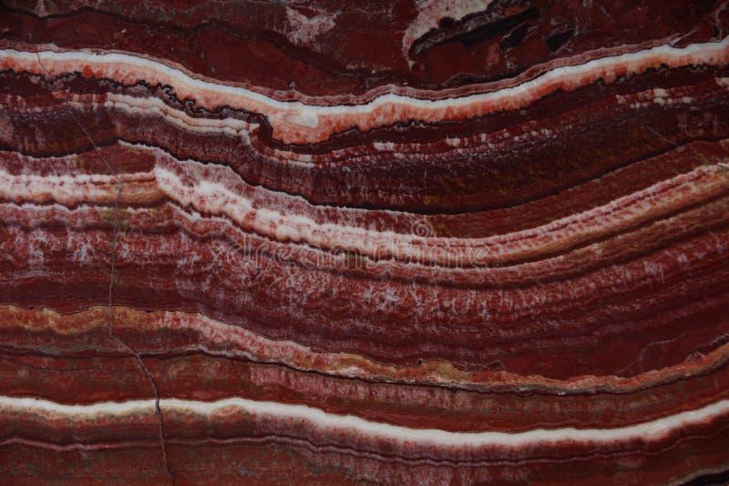 自然石头石华美好的背景红色与白色静脉,叫Onice Fantastico 图库摄影