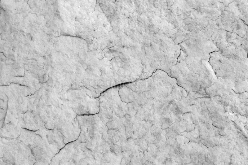 自然石花岗岩纹理与小镇压的 自然石灰色背景  与罚款的纹理 图库摄影