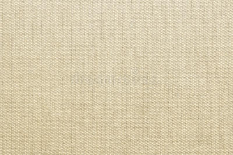 自然米黄色的亚麻制纹理或葡萄酒帆布背景 免版税库存图片