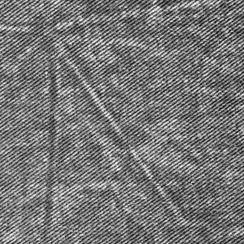 自然黑亚麻制牛仔布棉花牛仔裤纹理,大详细的宏观特写镜头穿着式样拷贝空间,灰色,白色 免版税库存图片