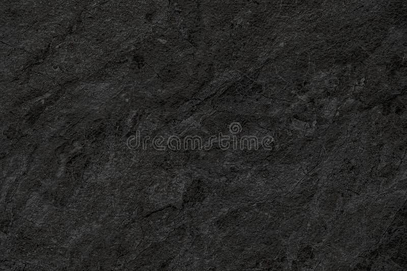 自然黑石墙背景或纹理背景的 库存照片