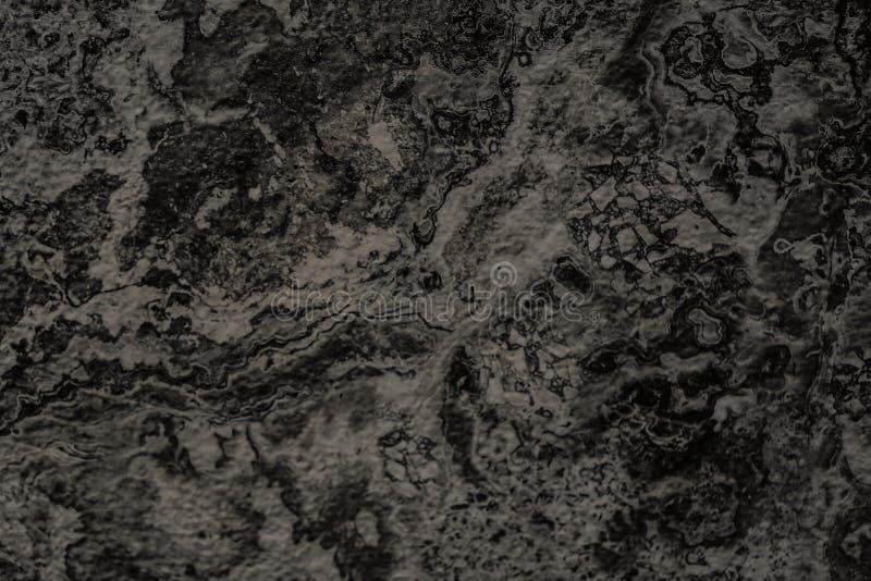 自然黑石墙背景或纹理背景的 免版税库存照片