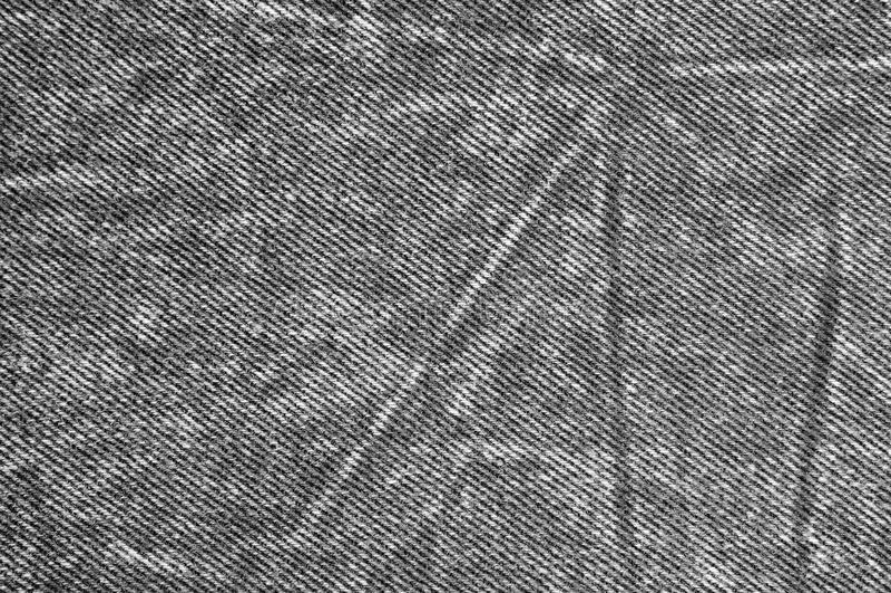 自然黑亚麻制牛仔布棉花丝光斜纹棉布牛仔裤纹理,详细的水平的织地不很细背景样式拷贝空间 免版税库存图片