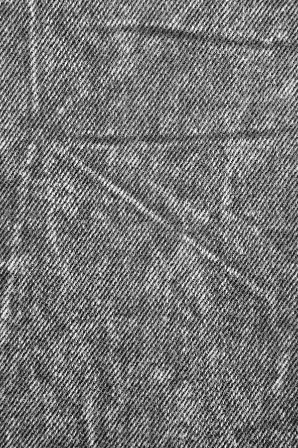 自然黑亚麻制牛仔布棉花牛仔裤纹理,大详细的垂直的宏观特写镜头穿着式样拷贝空间,灰色白色 免版税图库摄影