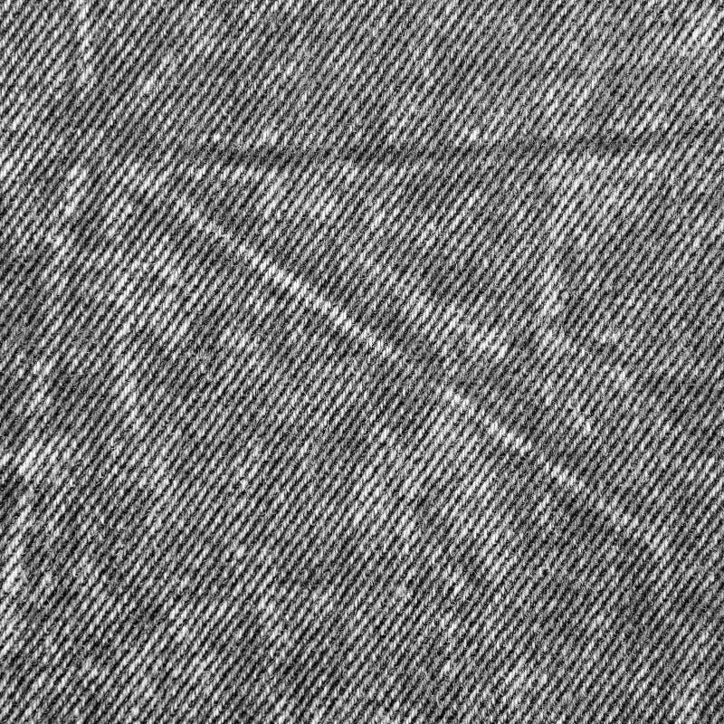 自然黑亚麻制牛仔布棉花牛仔裤纹理,大详细的宏观特写镜头,被佩带织地不很细砂洗样式拷贝空间灰色 免版税库存照片