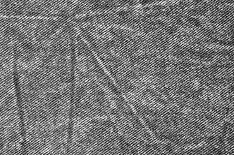 自然黑亚麻制牛仔布棉花牛仔裤纹理,大详细的水平的宏观特写镜头穿着式样拷贝空间,灰色,白色 库存图片