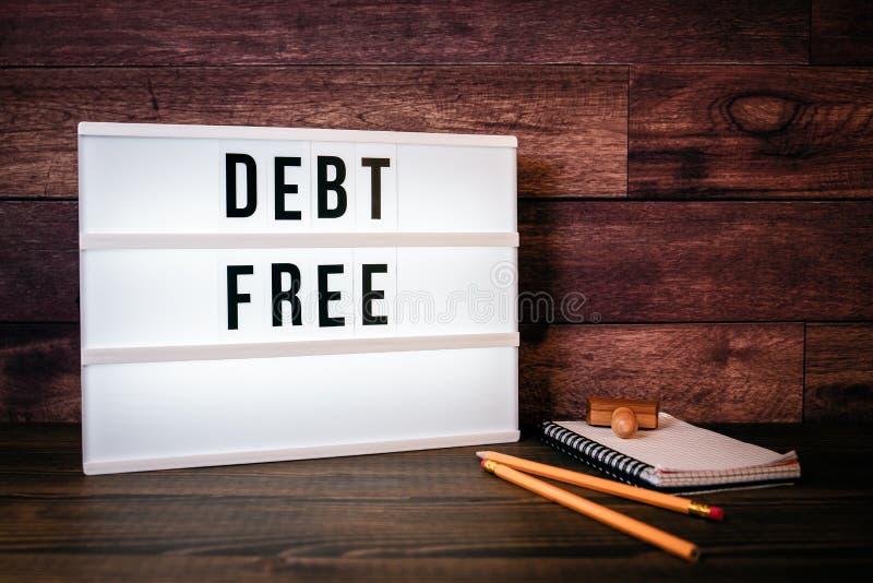 自由的债务 在lightbox的文本 图库摄影