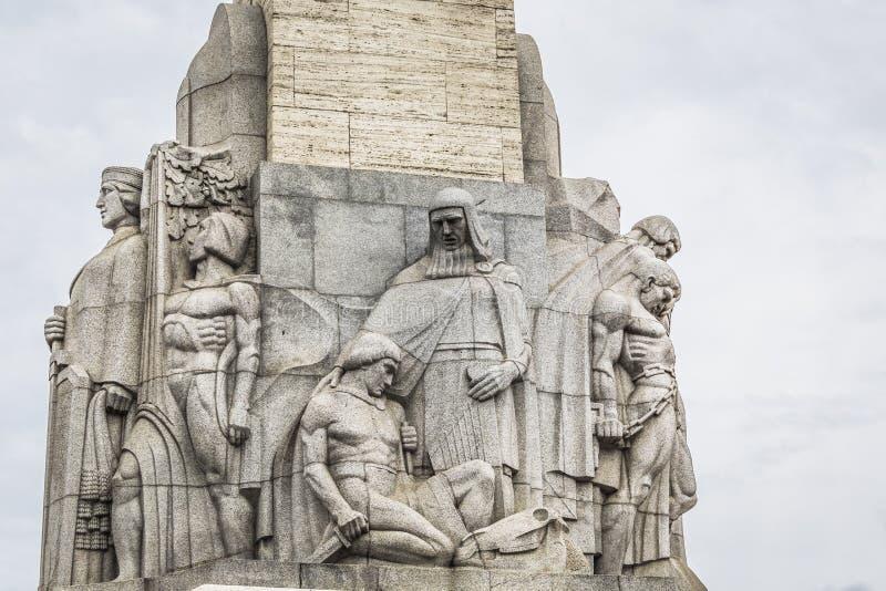 自由的纪念碑 拿着三个金星的妇女标志 免版税库存图片