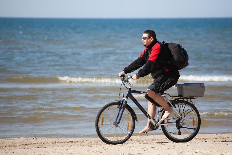 自行车人骑马 库存照片