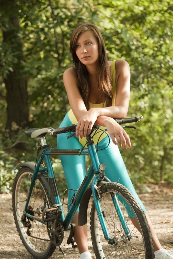 自行车健身妇女 图库摄影