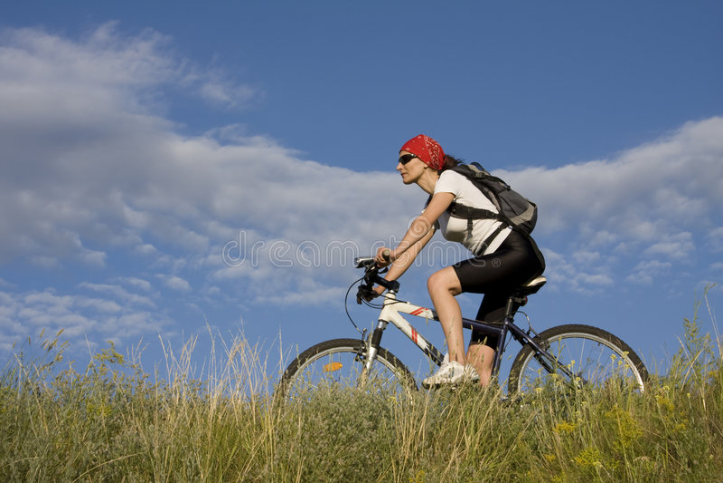 自行车妇女 库存照片