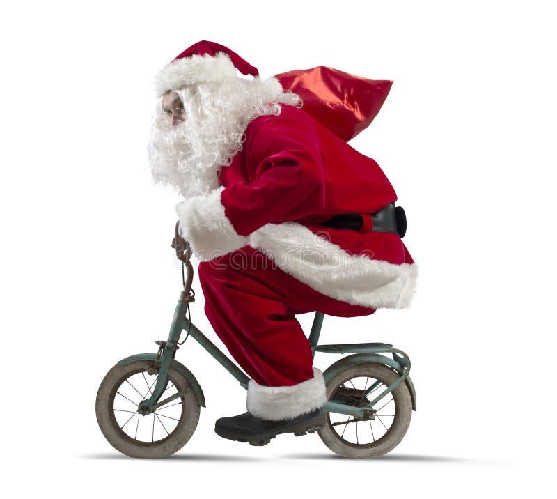 自行车的圣诞老人 库存图片