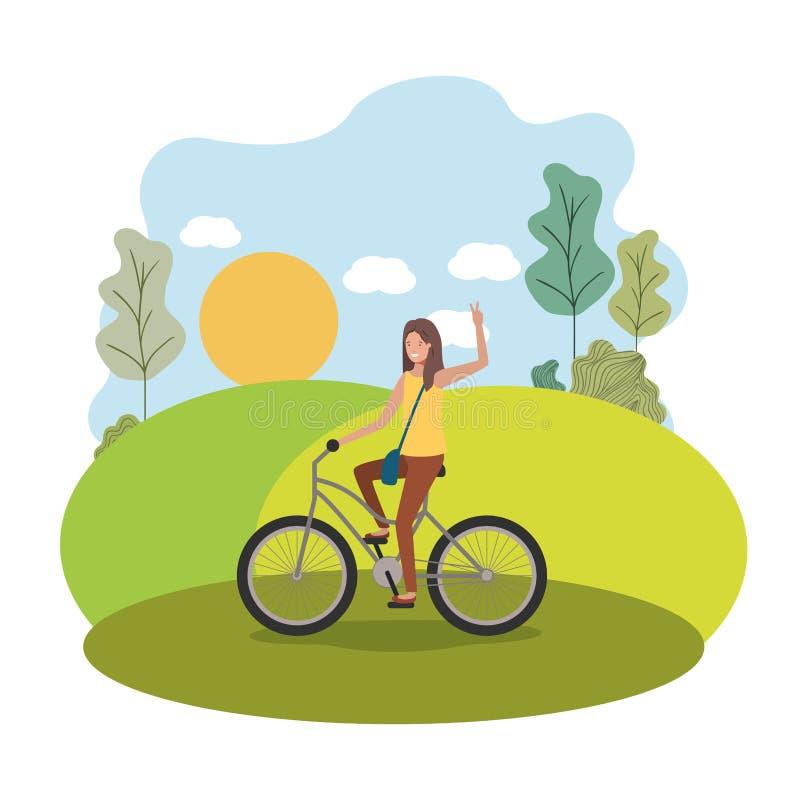 自行车的年轻女人在公园 皇族释放例证